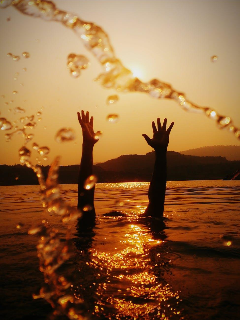 hands above water